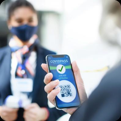 Senior woman showing smartphone with covidpass, coronavirus, travel and new normal.